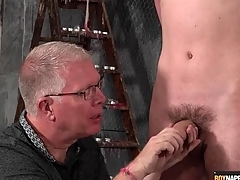 Adult BDSM versed gives twink a handjob