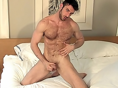 He probes his asshole with his moonless dildo all about alone yon bed