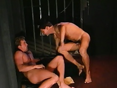 Lustful under lock engages in hardcore gay carry on in a gorgeous guard